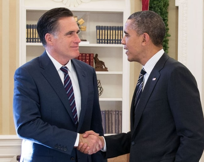 Mitt Romney (Left) as seen while shaking hands with President Barack Obama in the Oval Office following their lunch in November 2012