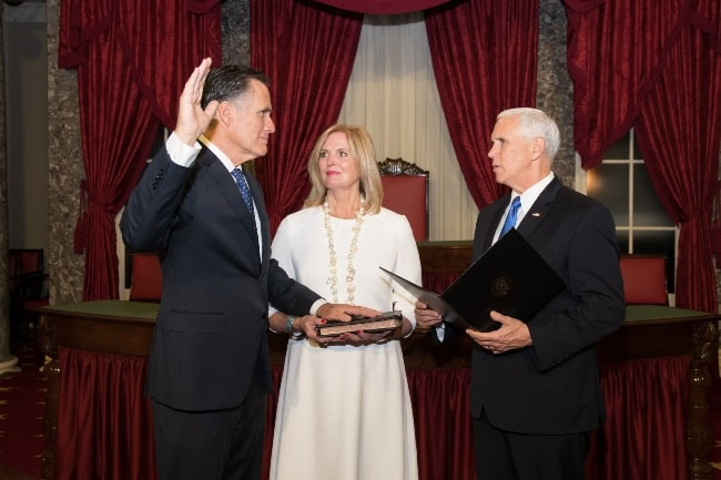 Mitt Romney (Left) being sworn in as a United States Senator from Utah by Vice President Mike Pence in the presence of Ann Romney in January 2019