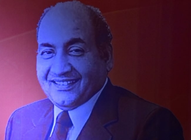 Mohammed Rafi as seen while smiling in a picture