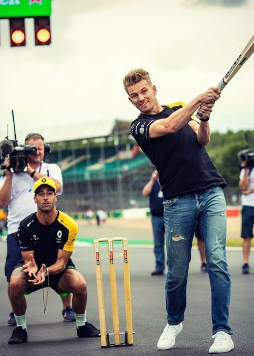 Nico Hülkenberg and Daniel Ricciardo playing Cricket on the sidelines of the 2019 British Grand Prix at the Silverstone Circuit