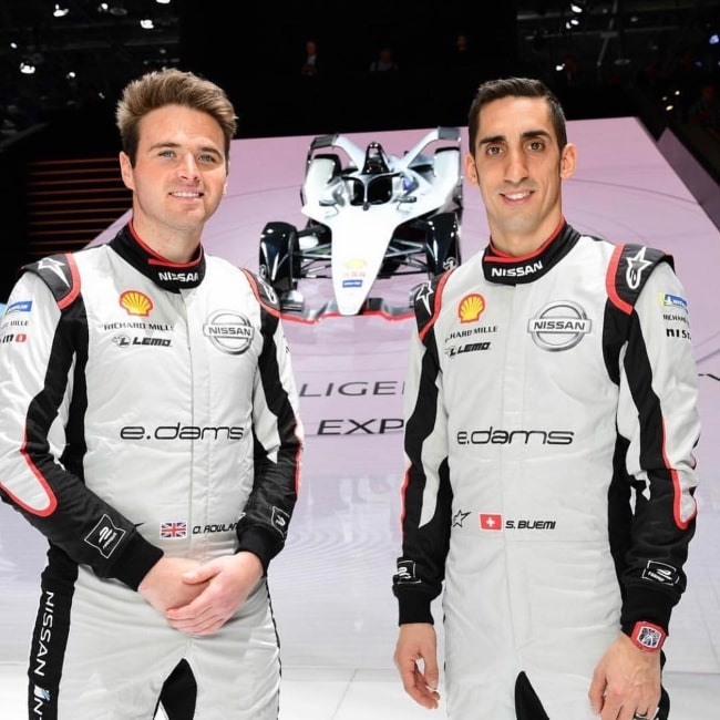 Oliver Rowland as seen in a picture taken with fellow race car driver Sébastien Buemi representing Nissan at the Geneva International Motor Show in Geneva in Switzerland in March 2019