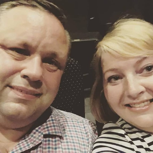 Paul Potts with his wife as seen in July 2019