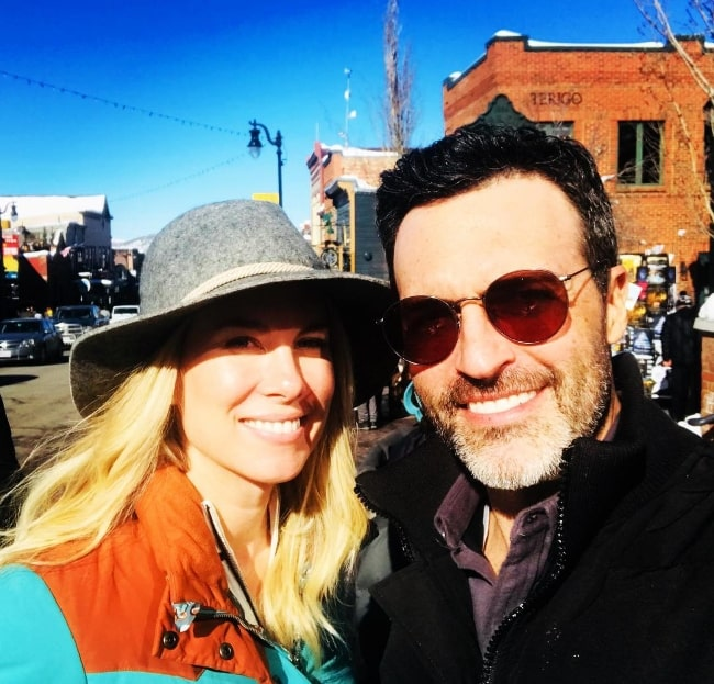 Reid Scott smiling in a picture alongside wife Elspeth Keller Scott