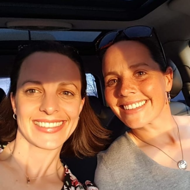 Rhian Wilkinson as seen in a selfie taken with her sister S. Wilkinson while on thier way to an event of Former First Laday Michelle Obama in March 2019