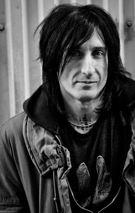Richard Fortus as seen in a black-and-white picture