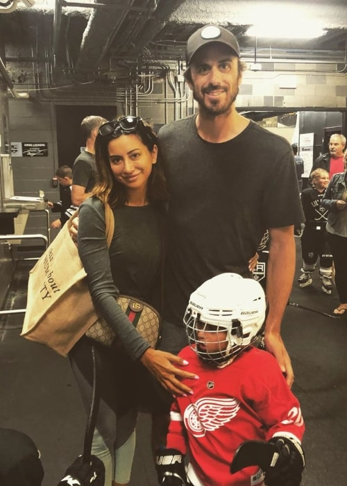 Ryan Miller as seen in a picture taken with his wife Noureen DeWulf at their son Bodhi Ryan's ice hockey match in July 2019