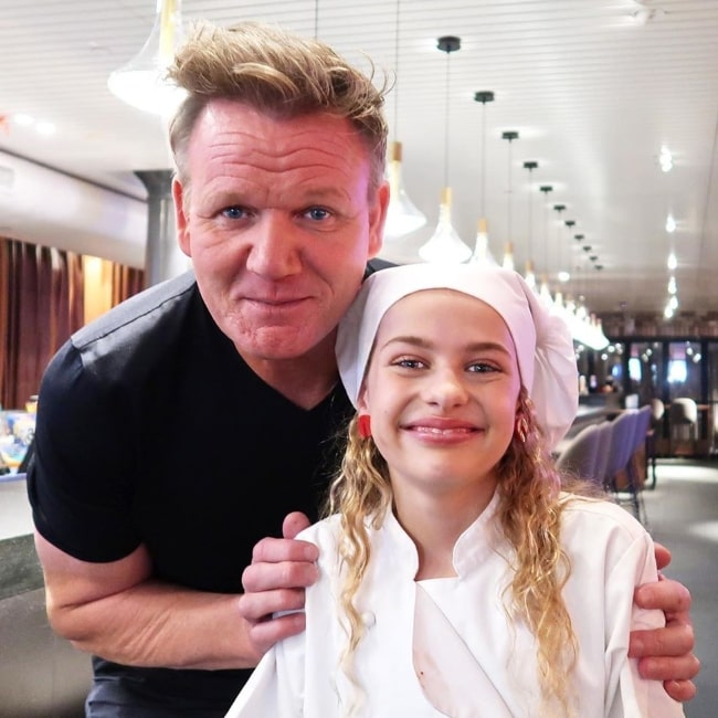Sockie Norris smiling in a picture along with the famous chef and TV personality, Gordon Ramsay, in February 2020