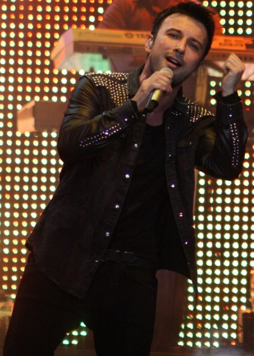Tarkan as seen while performing during an event in April 2011