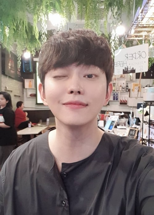 Yoon Kyun-sang as seen while winking in a selfie in July 2019