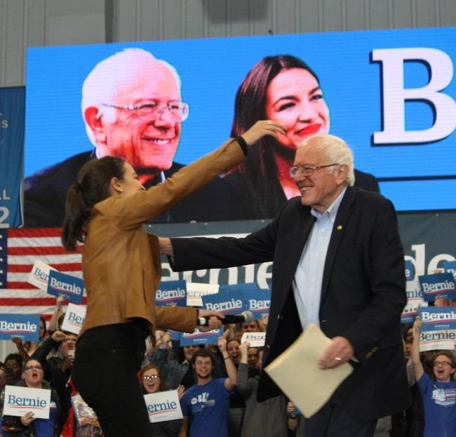 Alexandria Ocasio-Cortez and Sen. Bernie Sanders at a rally in Council Bluffs, Iowa in November 2019