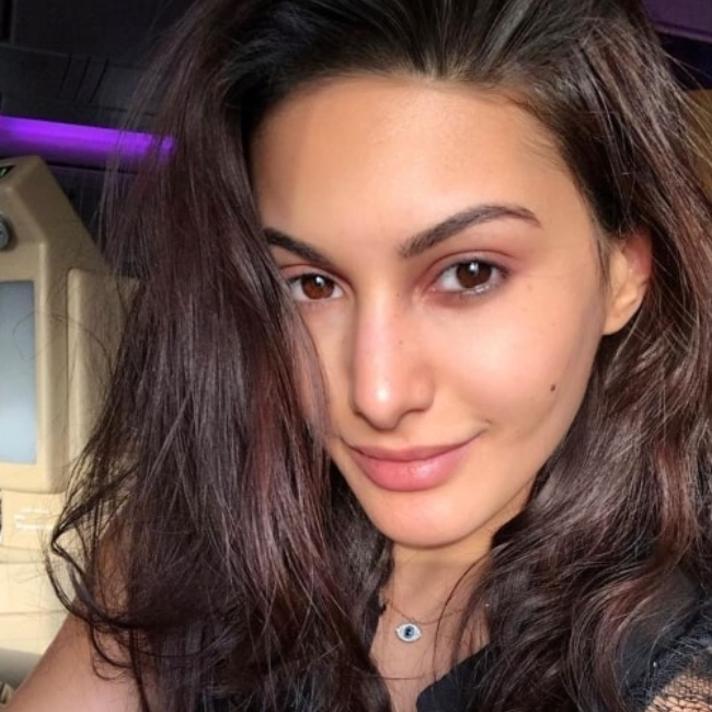 Amyra Dastur sharing the candid travel-selfie that she took at Abu Dhabi International Airport in June 2019