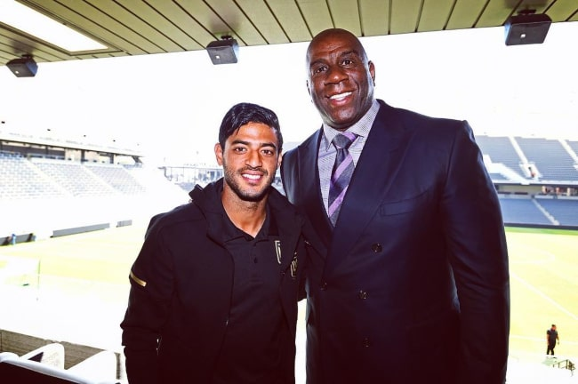 Carlos Vela with basketball legend Magic Johnson, as seen in April 2018