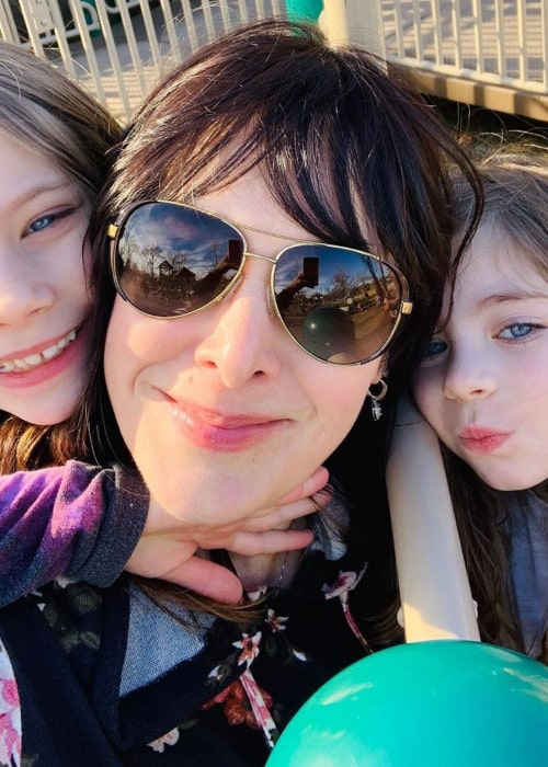 Danielle Brisebois with her twin daughters, as seen in January 2020