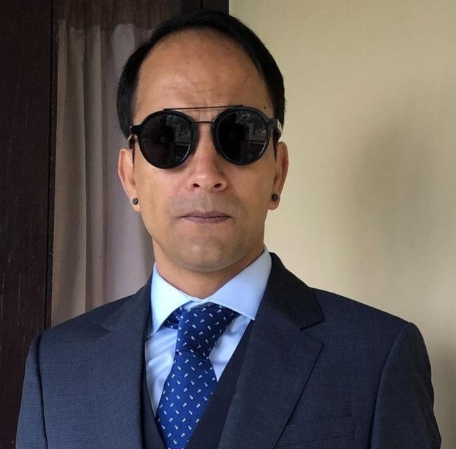 Deepak Dobriyal posing for a photo in his new look in November 2019