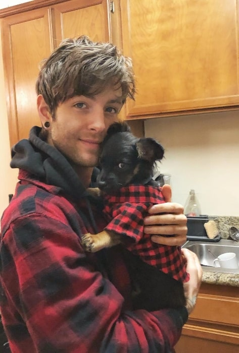 Drew Chadwick as seen while posing for a picture with a puppy in February 2019
