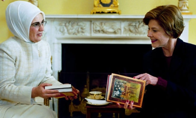 Emine Erdoğan (Left) as seen while presenting books of poetry by Persian poet Rumi to Laura Bush during a coffee at the White House on January 29, 2004