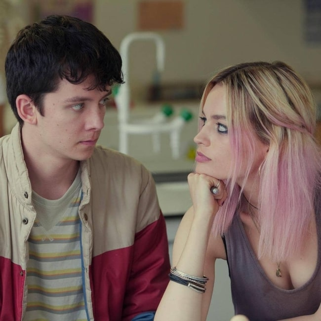 Emma Mackey as seen in a picture taken with her co-star Asa Butterfield while filming a scene for Netflix' show Sex Education in the past