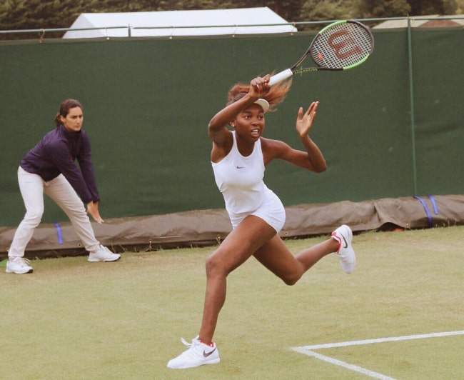 Françoise Abanda in action during a match at the 2017 Wimbledon Championships