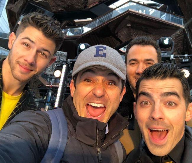 Fred taking a selfie with the Jonas Brothers (Nick Jonas, Kevin Jonas, and Joe Jonas) in 2019