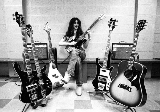 Geddy Lee on tour with various basses and an acoustic guitar