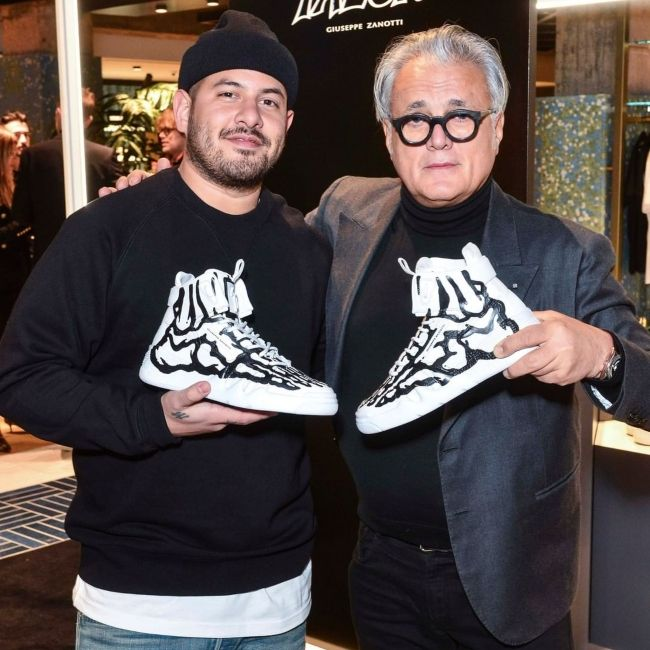 Giuseppe Zanotti seen with Joshua Vides during the launch of the Talon sneaker in 2020