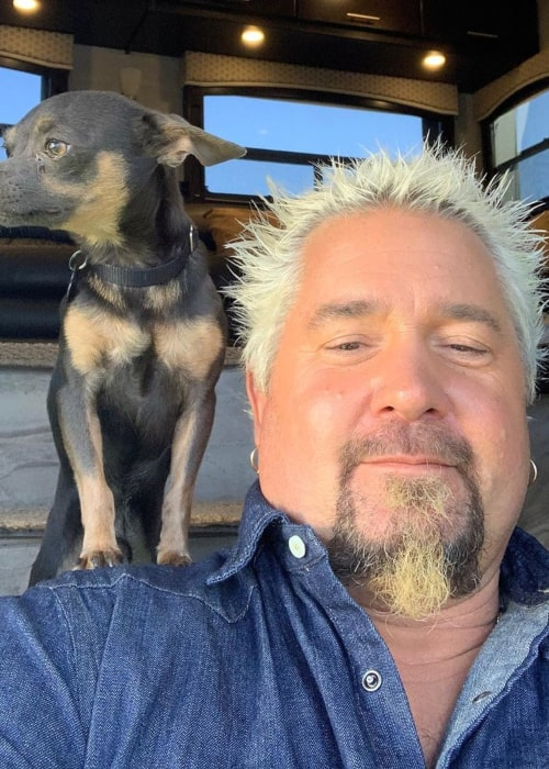 Guy Fieri with his pet dog, as seen in November 2019