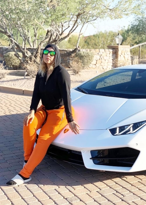 Jeddah Navalua as seen in picture taken while sitting on the hood of her Lamborghini in Scottsdale, Arizona in October 2018