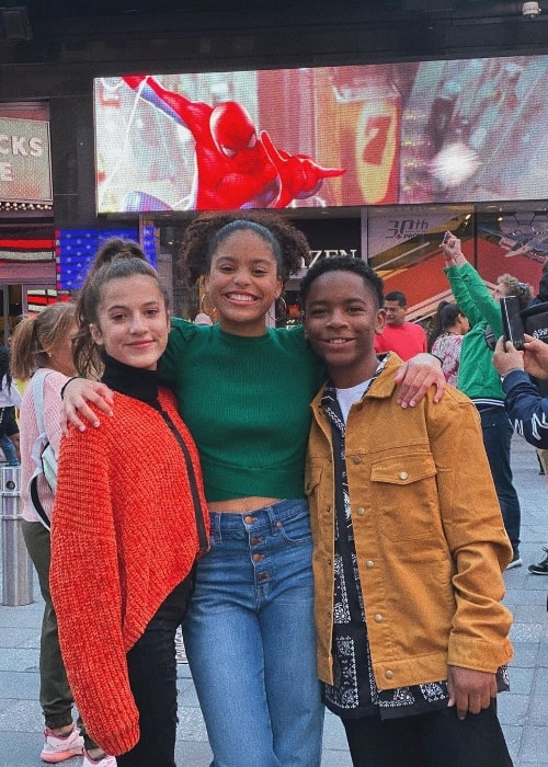 Kai Calhoun as seen while smiling in a picture along with Symera Jackson (Center) and Eliza Pryor at Times Square, New York City, New York in October 2019