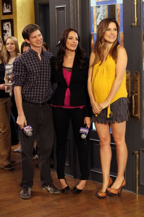 Lisa in a scene with co-stars Lee Norris and Sophia Bush from the show One Tree Hill