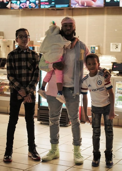Montana of 300 as seen in a picture taken with his son Tony Bradford and his daughter and youngest son on the day of his birthday in March 2020