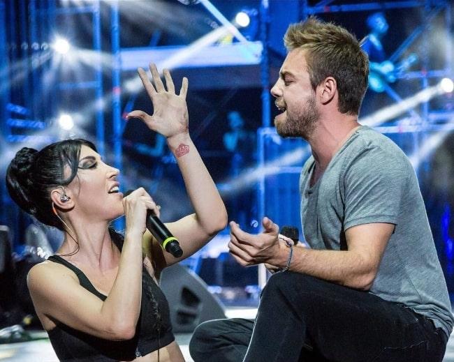 Murat Dalkılıç as seen while performing 'Görev' along with Hande Yener at Harbiye on August 9, 2016