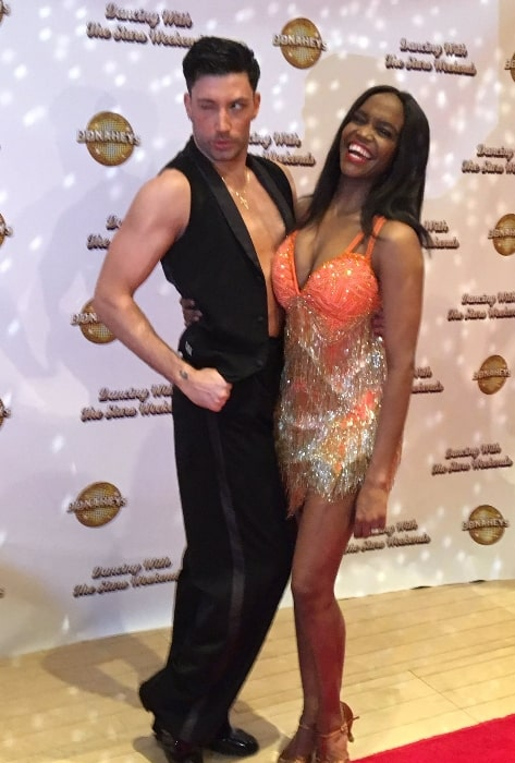 Oti Mabuse as seen while posing for the camera alongside Giovanni Pernice