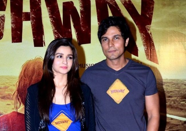 Randeep posing with Alia Bhatt for the first look launch of their film Highway