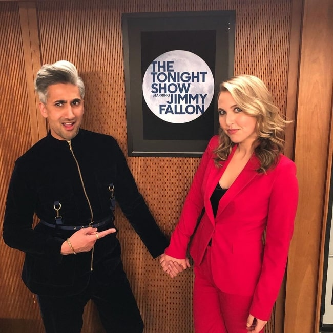 Taylor Tomlinson as seen while holding hands and posing for the camera along with Tan France during their time at 'The Tonight Show Starring Jimmy Fallon' in March 2020