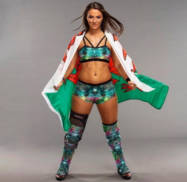 Tegan Nox wrapped in the Welsh flag, as seen in April 2019
