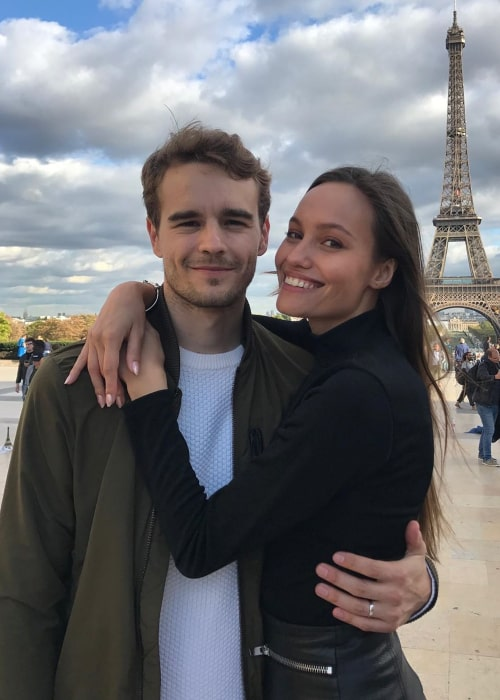 Tom Dillmann and Nicolle Taketa Schneider posing in front of the Eiffel Tower on Valentine's day in 2020