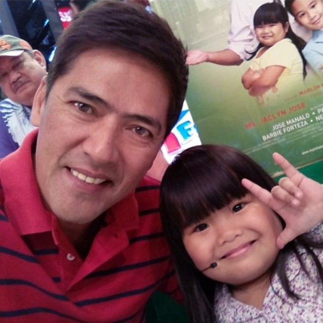 Vic Sotto as seen in a picture taken with Ryzza Mae Dizon during Bossing's Birthday Celebration on Eat Bulaga in February 2014