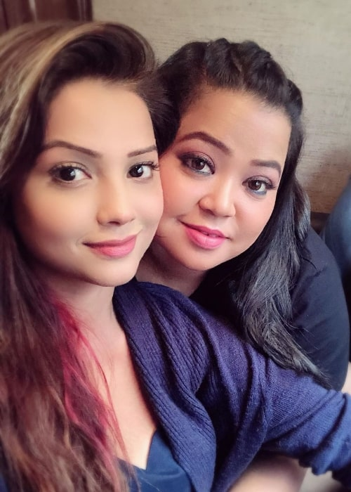 Adaa Khan (Left) as seen while taking a selfie along with comedian Bharti Singh in August 2019