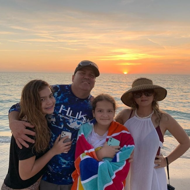 Alisson Sister Forever as seen in a picture taken with her father, mother, and younger sister Emily in March 2020, at the Coquina Beach