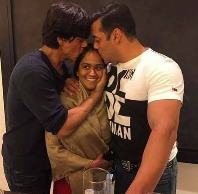 Arpita Khan being hugged by Shahrukh Khan and Salman Khan in March 2020