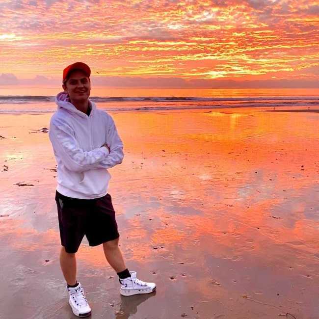 Carter Sharer as seen while posing for a picture by the beach enjoying the sunset in Malibu, California in December 2019