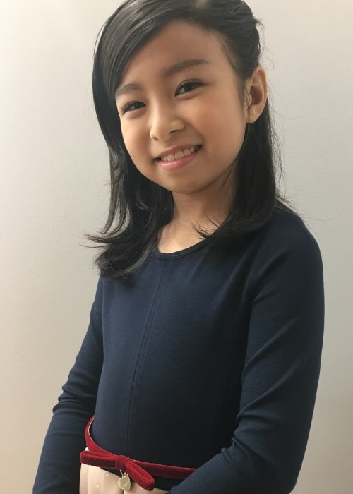 Celine Tam as seen while smiling for the camera in October 2017