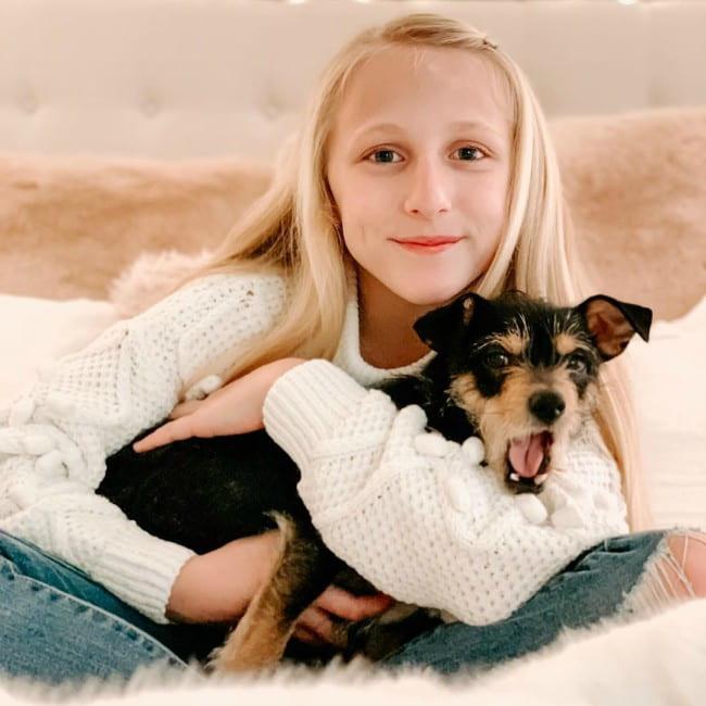 Clara Lukasiak with her dog as seen in December 2019