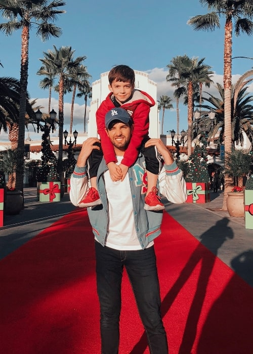 Daniel Preda as seen while posing for a picture along with his nephew at Universal Studios Hollywood in December 2019