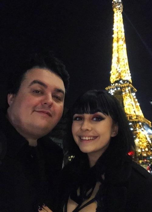 Daz Black smiling in a selfie alongside Soheila Clifford at Eiffel Tower in Paris, France in February 2020