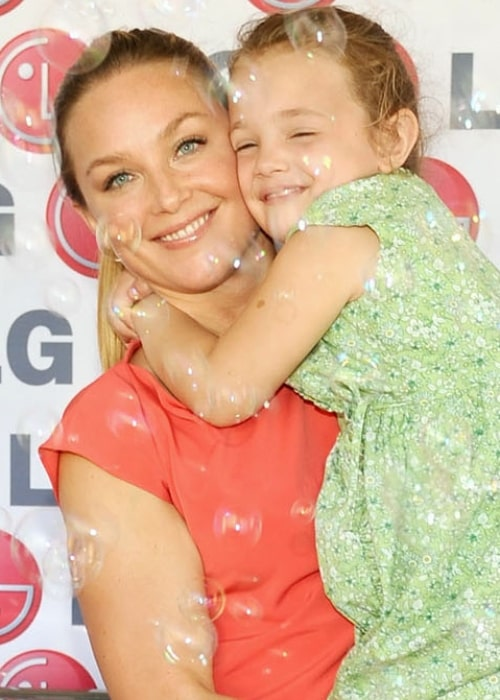 Elisabeth Röhm as seen in a picture taken with her __Daughter at the LG Washing Machine Drum, The Happiness of the United States 150 Million Women Keeper! in June 2012