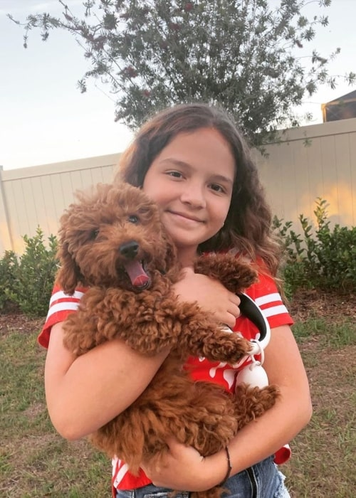 Emily Sister Forever as seen in a picture taken with her dog Chanel in March 2020