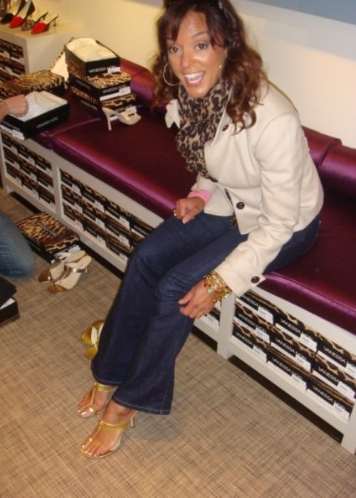 Eva LaRue trying on shoes at the Vanessa Noel boutique in New York