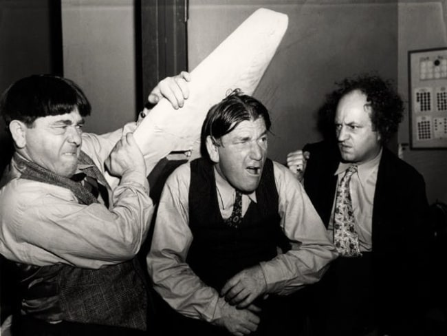 From Left to Right - Moe Howard, Shemp Howard, and Larry Fine (The Three Stooges) in a publicity still for 'Sing a Song of Six Pants' in 1947