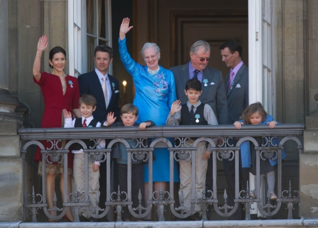 Henrik, Prince Consort of Denmark standing beside Queen Margrethe II as the Royal Family of Denmark waves to crowds on Queen Margrethe II's 70th birthday in April 2010